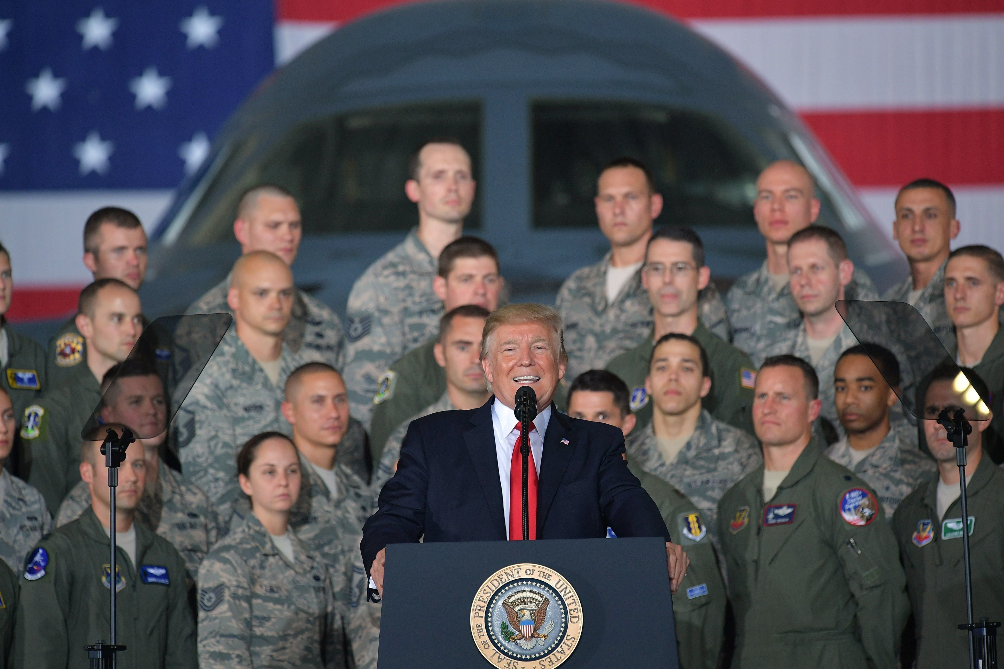 US President Donald Trump speaks to members of the military at Joint Andrews Airforce base, Maryland on September 15, 2017.   / AFP PHOTO / MANDEL NGAN        (Photo credit should read MANDEL NGAN/AFP/Getty Images)