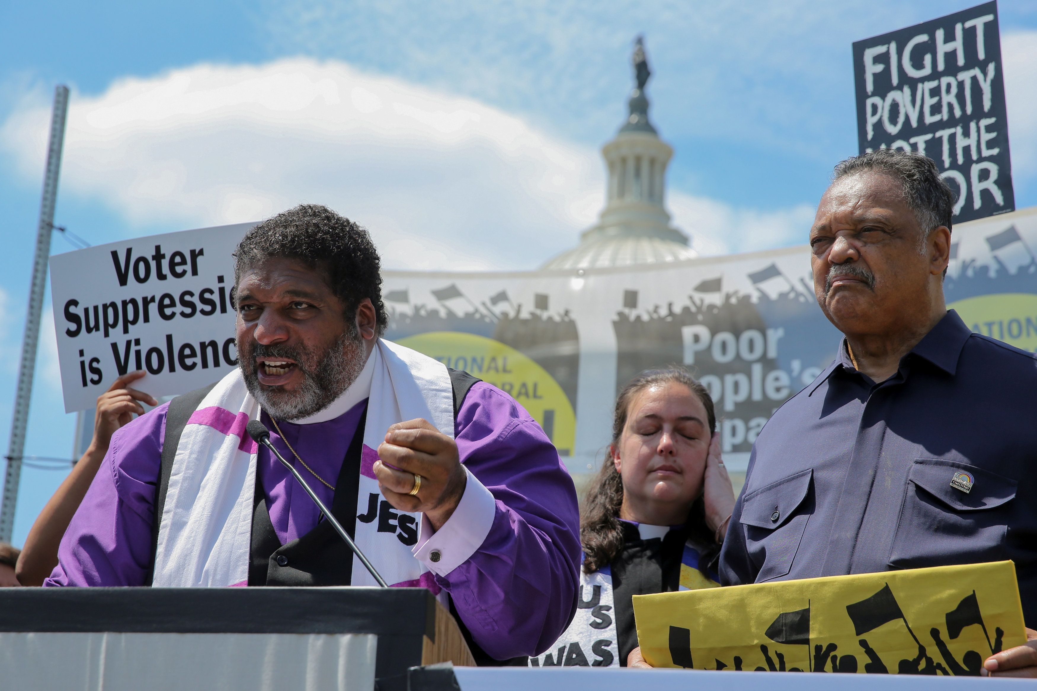 Rev. William Barber (L), Rev. Jesse Jackson (R) and Liz Theoharis (C) hold a Poor People's Campaign rally at the U.S. Capitol in Washington, U.S. May 21, 2018.  REUTERS/Jonathan Ernst