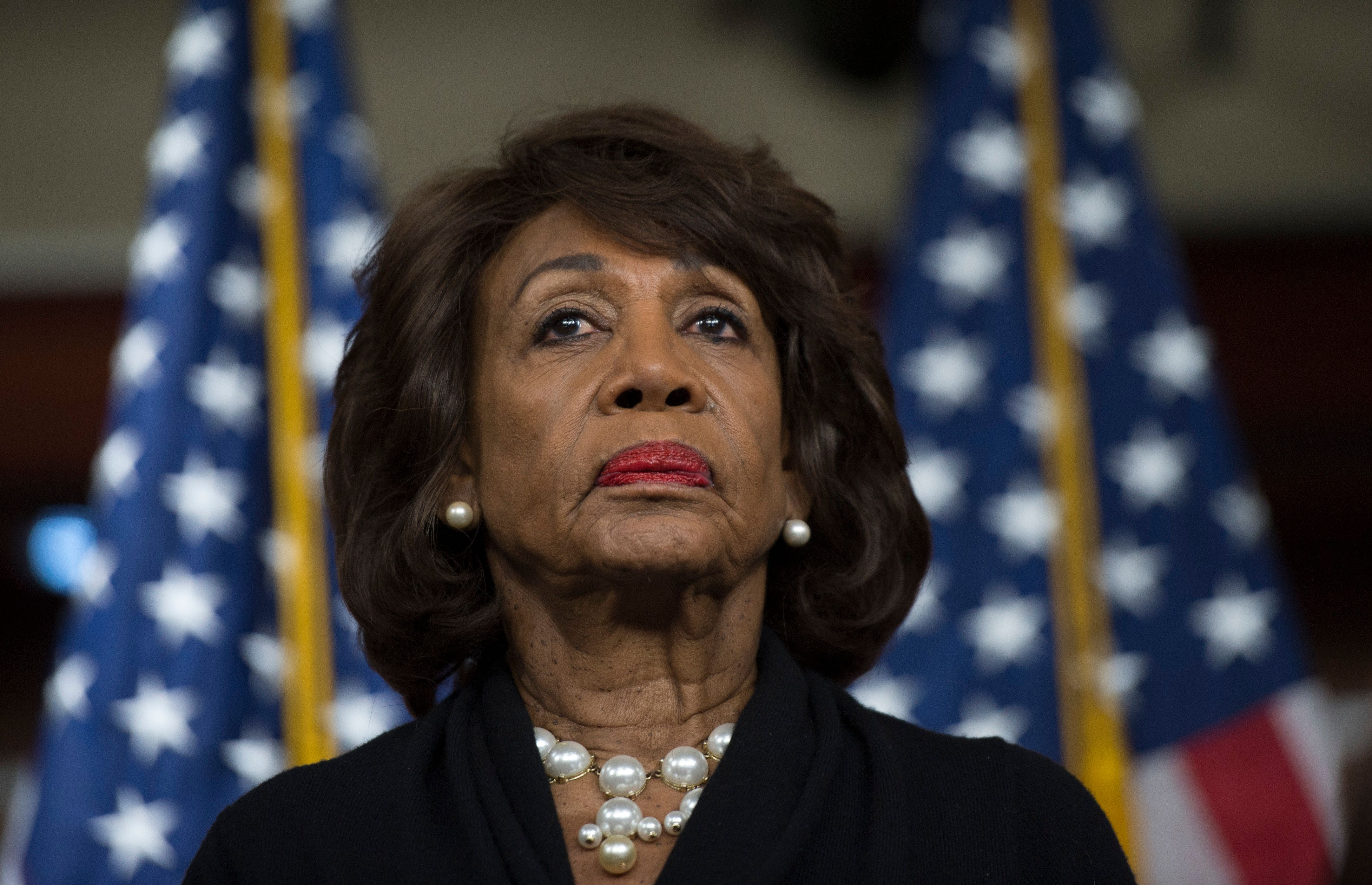 US Representative Maxine Waters (D-CA) looks on before speaking to reports regarding the Russia investigation on Capitol Hill in Washington, DC on January 9, 2018. / AFP PHOTO / Andrew CABALLERO-REYNOLDS        (Photo credit should read ANDREW CABALLERO-REYNOLDS/AFP/Getty Images)