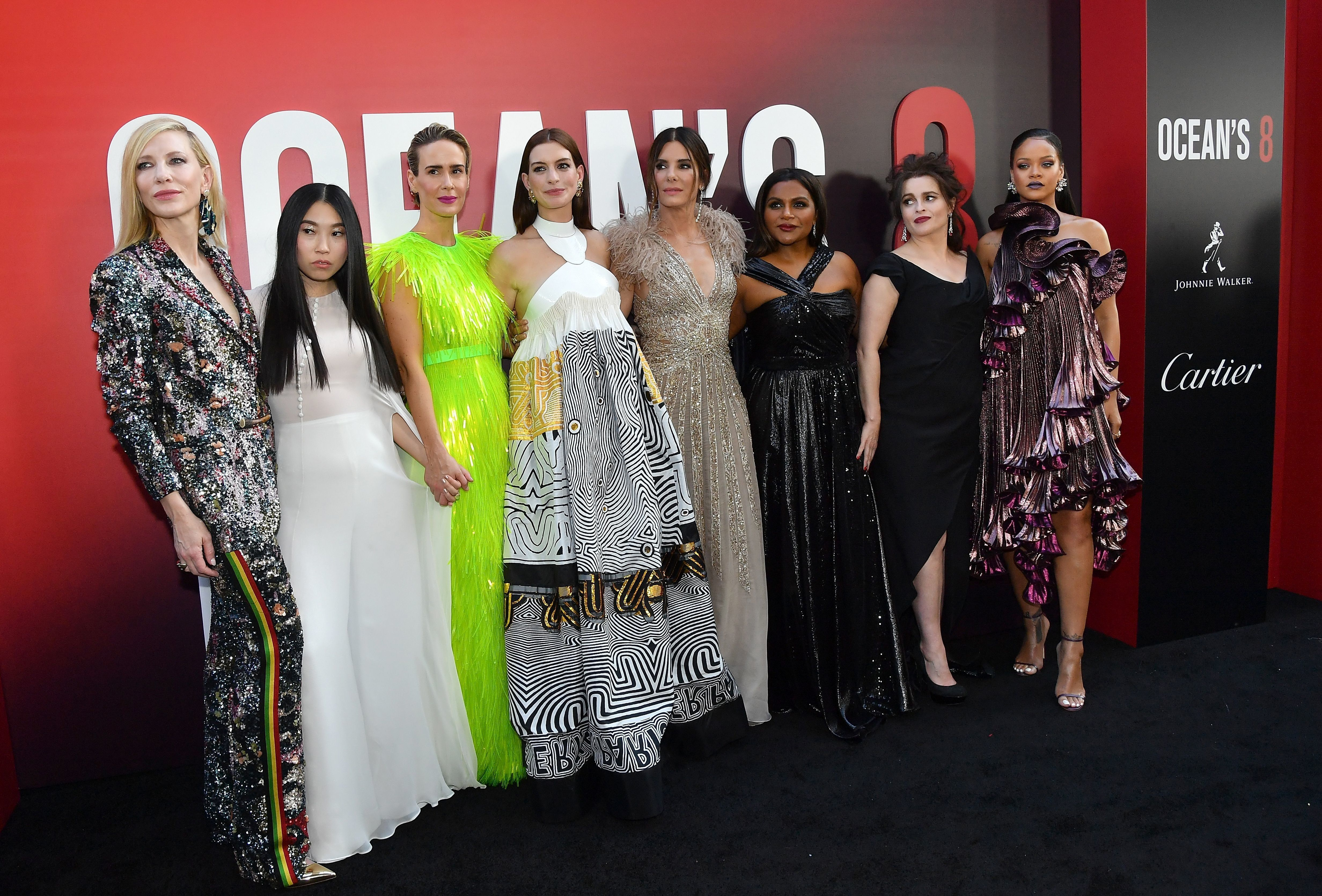 Members of the cast (fromL) Australian actress Cate Blanchett, rapper/actress Awkwafina, US actresses Sarah Paulson, Anne Hathaway, Sandra Bullock, Mindy Kaling, British actress Helena Bonham Carter and Barbadian singer/actress Rihanna attend the world premiere of Ocean's 8 on June 5, 2018 in New York. - Ocean's 8 will be released nationwide on June 8, 2018. (Photo by ANGELA WEISS / AFP)        (Photo credit should read ANGELA WEISS/AFP/Getty Images)