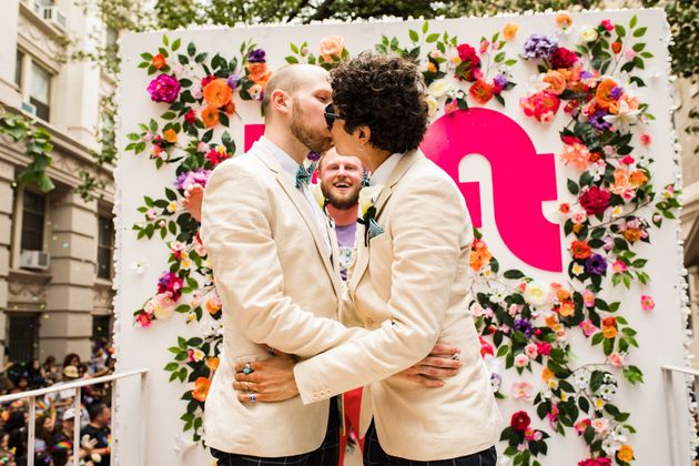 Berk (rear) officiated the wedding of Andrew Pharis and Guillermo Irias during the New York Pride...