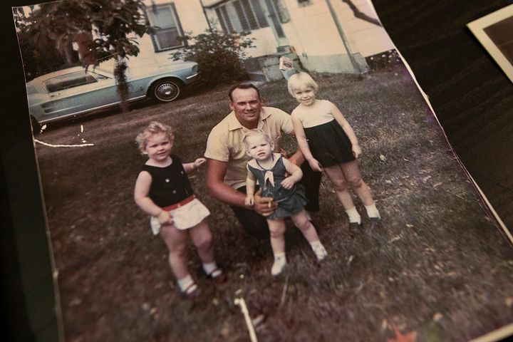 A 1971 family photo shows Christal Collins (left), her father, Bill Collins, and her sisters, Tracy and Marie.