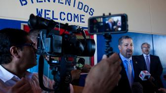 KARNES CITY, TX - JULY 31:  San Antonio Office Director Enrique M. Lucero talks to members of the media at the Karnes County Residential Center is viewed on July 31, 2014 in Karnes City, Texas.  The civil facility is being used by U.S. Immigration and Customs Enforcement (ICE) to accomodate the increase of adults with children who have been apprehended illegally crossing the Southwest border. (Photo by Drew Anthony Smith/Getty Images)