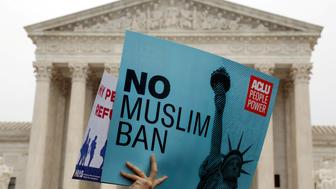 Protesters rally outside the U.S. Supreme Court, while the court justices consider case regarding presidential powers as it weighs the legality of President Donald Trump's latest travel ban targeting people from Muslim-majority countries, in Washington, DC, U.S., April 25, 2018. REUTERS/Yuri Gripas
