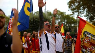 Ultra right wing demonstrators make fascist salute during Spain's National Day in Barcelona, Spain October 12, 2017. REUTERS/Ivan Alvarado