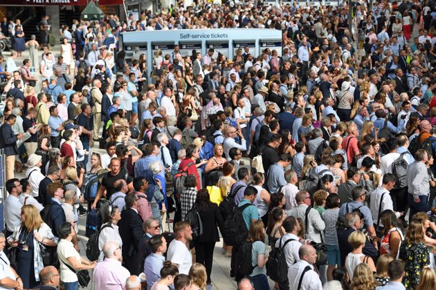Commuters at Waterloo Station, London, as rail services to and from the railway station were disrupted...