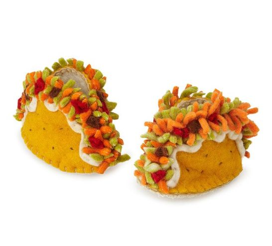 """$25, get it <a href=""""https://www.uncommongoods.com/product/taco-booties"""" target=""""_blank"""">here</a>."""