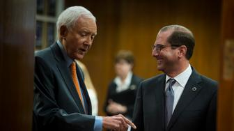 UNITED STATES - June 26: Secretary of Health and Human Services Alex Azar speaks with Sen. Orrin Hatch, R-Utah, before testifying at a hearing called 'Prescription Drug Affordability and Innovation: Addressing Challenges in Today's Market' in front of the Senate Finance Committee in the Dirksen Senate Office Building Tuesday June 26, 2018 (Photo By Sarah Silbiger/CQ Roll Call)