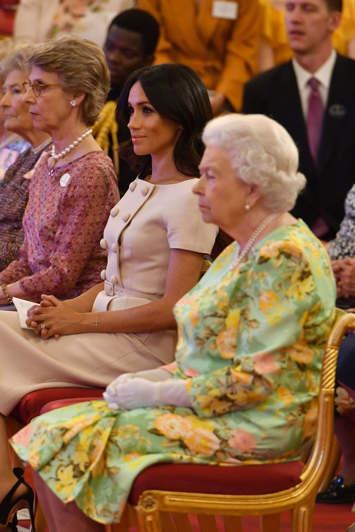 Queen Elizabeth II with the Duchess of Sussex at the Queen's Young Leaders Awards ceremony at Buckingham Palace.