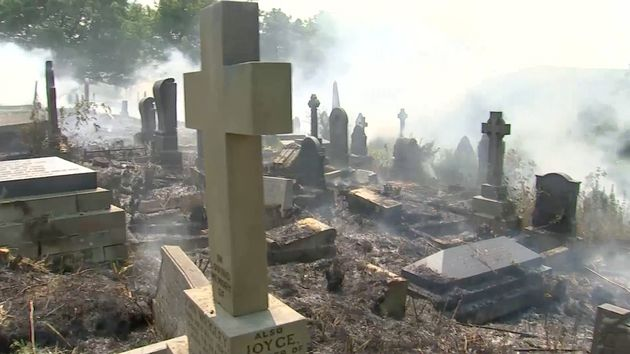 Graves were shrouded in thick smoke as the wildfire flourished in the cemetery outside Manchester on