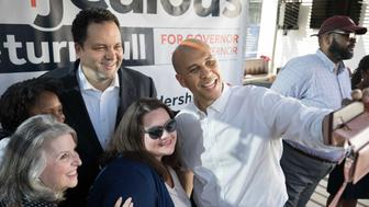 Silver Spring, Md. - June 14: Candidate for Maryland Governor Ben Jealous, top center, is joined by Sen. Cory Booker, right, who takes a selfie with Jealous, candidate for Lt. Governor Susan Turnbull, Keila Foster and Cora Goecke, left to center, during a campaign event on the first day of Maryland early voting in Silver Spring, Md., on June 14, 2018. 'I'm a teacher, and the Maryland State Education Association supports him,' said Foster. Jealous is a former national president and CEO of the NAACP. (Photo by Cheryl Diaz Meyer for The Washington Post via Getty Images)