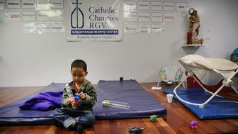 MCALLEN, TX - JUNE 21: A Honduran child plays at the Catholic Charities Humanitarian Respite Center after recently crossing the U.S., Mexico border with his father on June 21, 2018 in McAllen, Texas. Once families and individuals are released from Customs and Border Protection to continue their legal process, they are brought to the center to rest, clean up, enjoy a meal and get guidance to their next destination. Before Trump signed an executive order yesterday that the administration says halts the practice of separating families seeking asylum, more than 2,300 immigrant children had been separated from their parents in the  zero-tolerance policy for border crossers. (Photo by Spencer Platt/Getty Images)