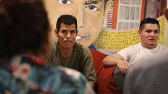 EL PASO, TX - JUNE 25:  Melvin (L), who migrated from Honduras, and Cristian, who migrated from Guatemala, neither of whom wanted to provide their last names, wait at the Annunciation House  to hear from the Office of Refugee Resettlement about their children after being released from U.S. Customs and Border Protection custody on June 25, 2018 in El Paso, Texas. Cristian and Melvin are part of a group of 32 parents that arrived at the Annunciation House migrant shelter as they wait to be reunited with their children.  (Photo by Joe Raedle/Getty Images)