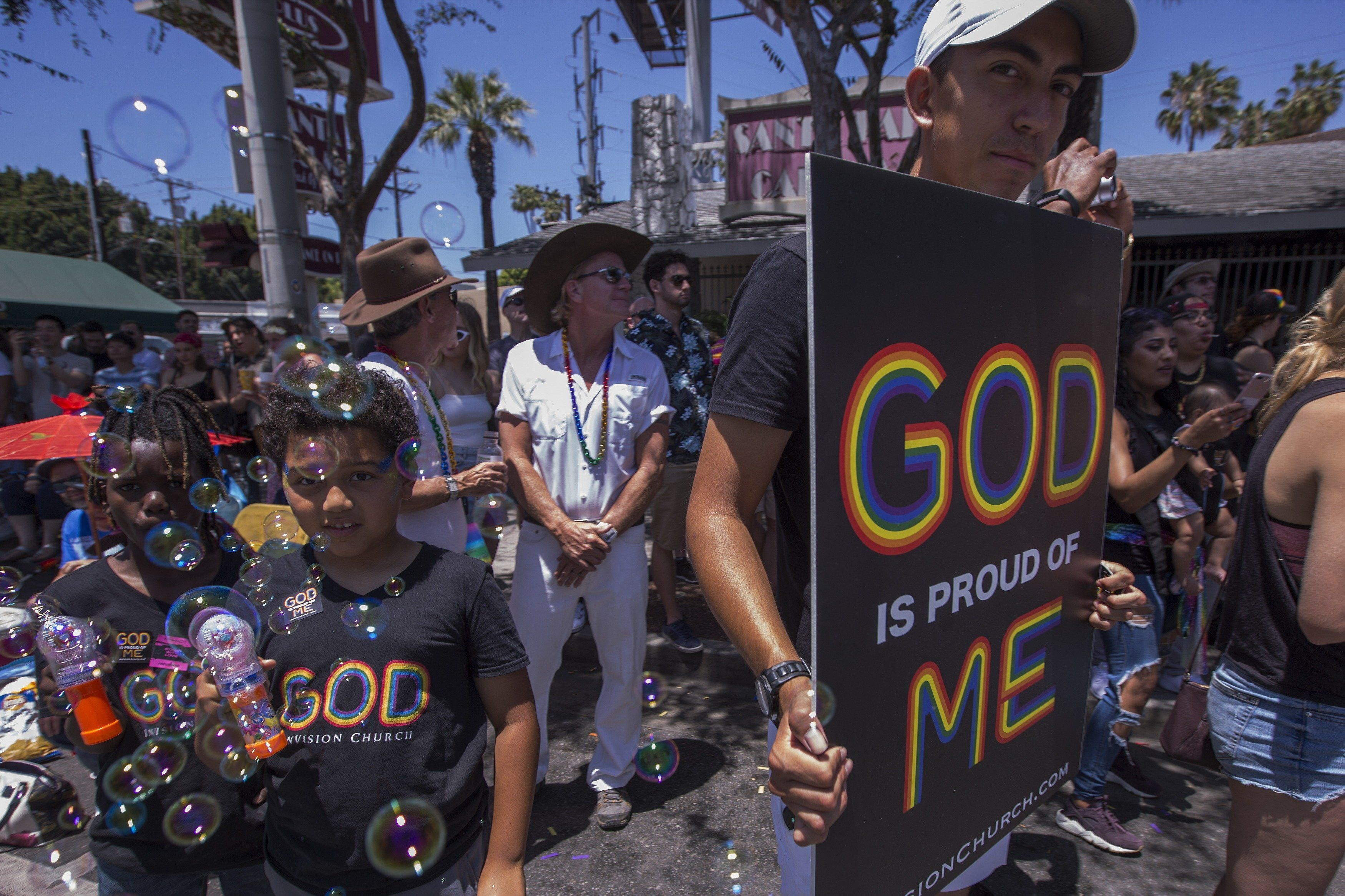 LOS ANGELES, CA - JUNE 10: A supporter of InVision Church Los Angeles watches the 48th annual LA Pride Parade on June 10, 2018, in the Hollywood section of Los Angeles and West Hollywood, California. The annual gay rights event returns to its customary format of celebration following a one-time switch to the Resist March protest against Trump administration policies. LA Pride began on June 28, 1970, exactly one year after the historic Stonewall Rebellion in New York City.  (Photo by David McNew/Getty Images)