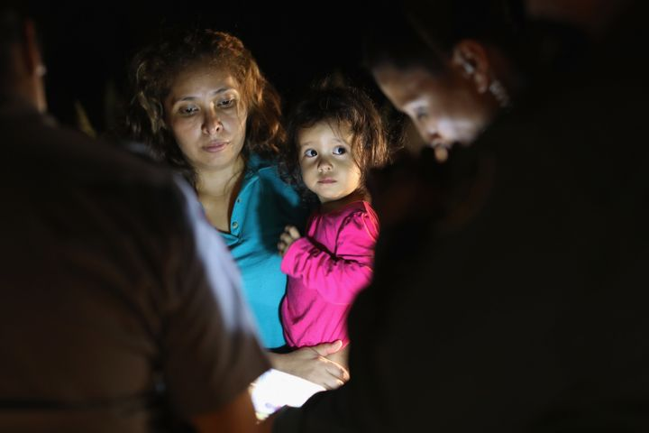Central American asylum seekers, including a Honduran girl, 2, and her mother, are taken into custody near the U.S.-Mexico bo