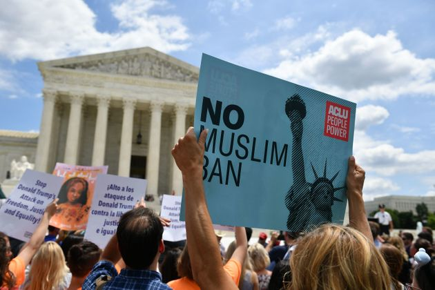 People protest the Muslim travel ban outside of the U.S. Supreme Court in Washington, D.C., on June 26,