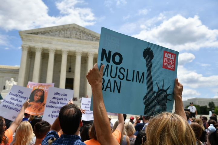 People protest the Muslim travel ban outside of the U.S. Supreme Court in Washington, D.C., on June 26, 2018.