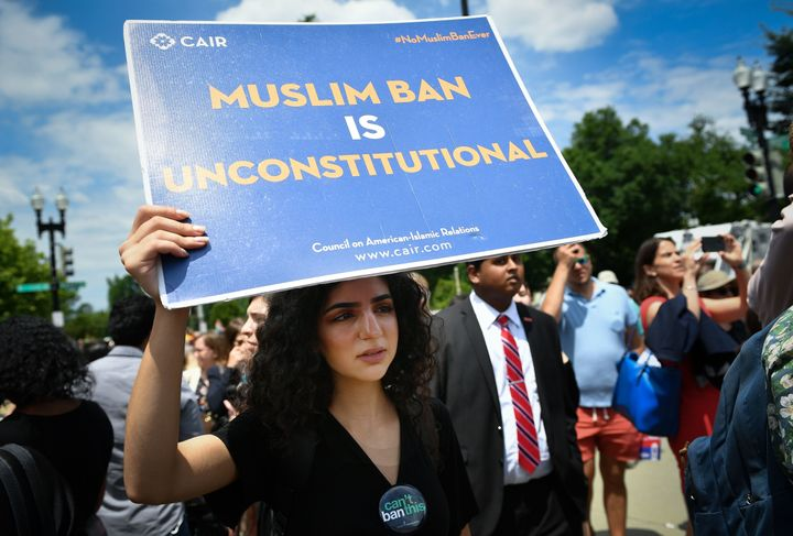 People protest Trump's travel ban outside the Supreme Court on June 26, 2018.