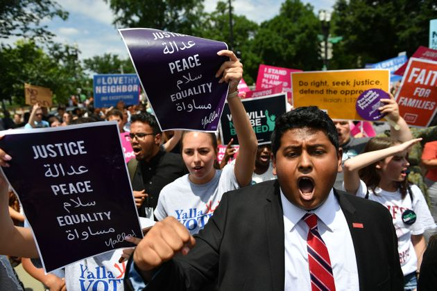 People protest the Muslim travel ban outside of the US Supreme Court in Washington, DC on June 26,
