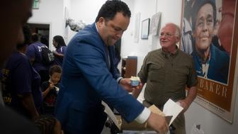 BALTIMORE MD-JUNE 23 Ben Jealous (left) and Ben Cohen (right) who is one half of Ben and Jerry's ice-cream gives out free ice-cream to supporters in Baltimore, Maryland  on June 23, 2018. (Photo by Marvin Joseph/The Washington Post via Getty Images)