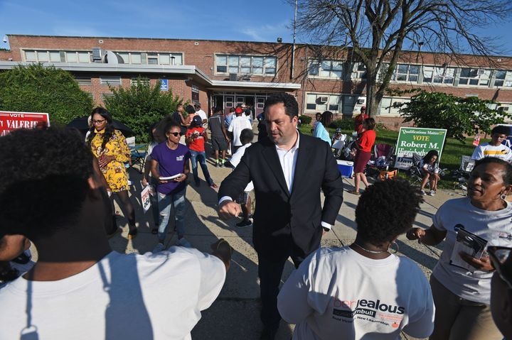 Democratic gubernatorial candidate Ben Jealous thanks his campaign workers during a visit to a polling place in Baltimore on