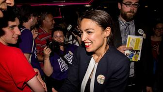 NEW YORK, NY - JUNE 26: Progressive challenger Alexandria Ocasio-Cortez celebrartes with supporters at a victory party in the Bronx after upsetting incumbent Democratic Representative Joseph Crowly on June 26, 2018 in New York City.  Ocasio-Cortez upset Rep. Joseph Crowley in New York's 14th Congressional District, which includes parts of the Bronx and Queens. (Photo by Scott Heins/Getty Images)
