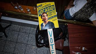 NEW YORK, NY - JUNE 26: A sign for progressive challenger Alexandria Ocasio-Cortez at her victory party in the Bronx after an upset against incumbent Democratic Representative Joseph Crowly on June 26, 2018 in New York City. Ocasio-Cortez upset Rep. Joseph Crowley in New York's 14th Congressional District, which includes parts of the Bronx and Queens. (Photo by Scott Heins/Getty Images)