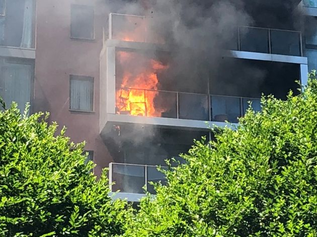 Flames engulfed the balcony of an apartment at a luxury development near Battersea on