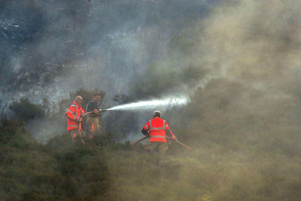 Firefightersare still battling the fire amid balmy heatwave