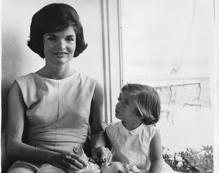 Kennedy and her daughter Caroline. Caroline was born via planned cesarean section in 1957 following the stillborn birth of Kennedy's daughter Arabella in 1956.