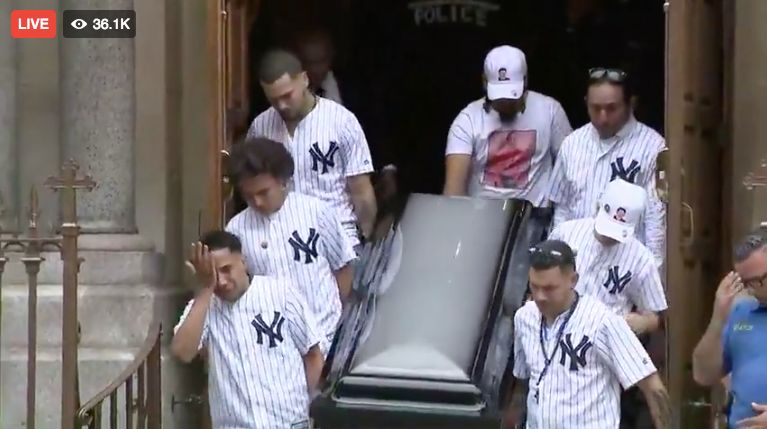 Pallbearers wearing matching New York Yankees jersey carry the casket of 15-year-old Lesandro Junior Guzman-Feliz on Wednesday