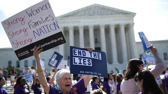 WASHINGTON, DC - JUNE 26:  Supporters of women's rights protest outside the U.S. Supreme Court as the court issues a ruling on a California law related to abortion issues on June 26, 2018 in Washington, DC. A Calfornia law requiring 'pregnancy crisis centers' to inform women of abortion options was ruled as a likely violation of first amendment rights by the court.  (Photo by Win McNamee/Getty Images)