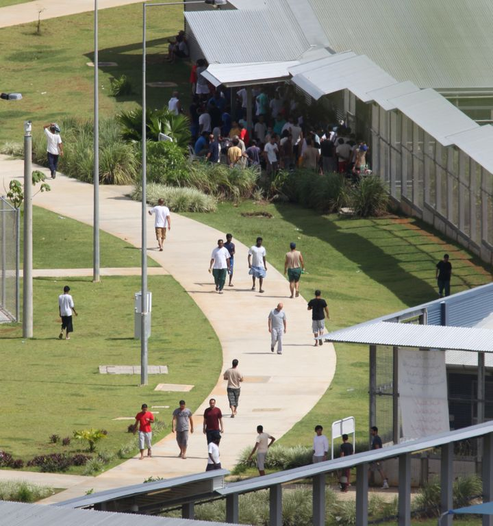 Asylum-seekers walking around inside the detention center compound on Christmas Island.