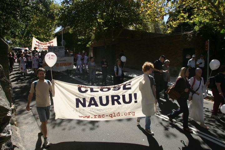 A small group of activists staged a protest at the front of Prime Minister John Howard's residence, Kirribilli House, demandi