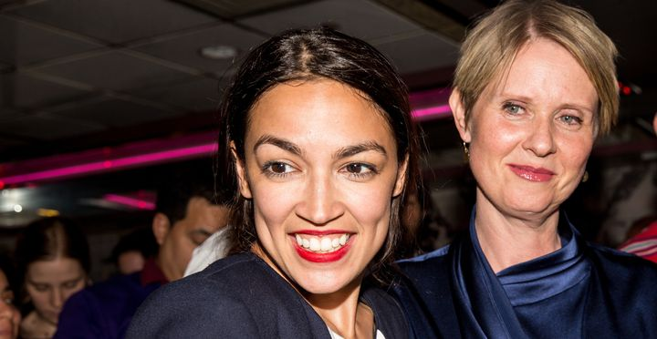 Alexandria Ocasio-Cortez, joined by gubernatorial candidate Cynthia Nixon (right), celebrates her upset victory on June 26.