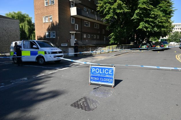 A police cordon on Prewett Street, Bristol, where man died and two menwere taken to hospital with...