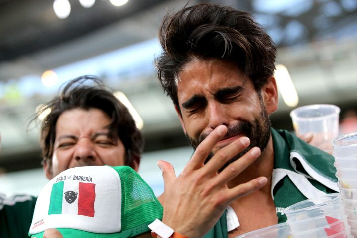 Mexico's fans react as their team loses to Sweden at Russia's Ekaterinburg Arena Stadium.