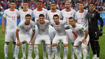 (Back L to R) Switzerland's defender Fabian Schaer, midfielder Granit Xhaka, defender Manuel Akanji, defender Ricardo Rodriguez, midfielder Valon Behrami, defender Stephan Lichtsteiner, goalkeeper Yann Sommer, (front L to R) forward Haris Seferovic, midfielder Steven Zuber, midfielder Blerim Dzemaili, forward Xherdan Shaqiri pose for a photo before their Russia 2018 World Cup Group E football match between Serbia and Switzerland at the Kaliningrad Stadium in Kaliningrad on June 22, 2018. (Photo by OZAN KOSE / AFP) / RESTRICTED TO EDITORIAL USE - NO MOBILE PUSH ALERTS/DOWNLOADS        (Photo credit should read OZAN KOSE/AFP/Getty Images)