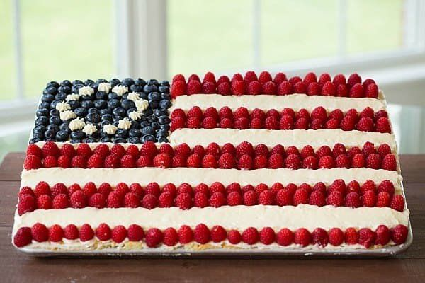 "<strong>Get the <a href=""https://www.browneyedbaker.com/flag-cake-recipe-from-scratch/"" target=""_blank"">Scratch Flag Cake</a>"