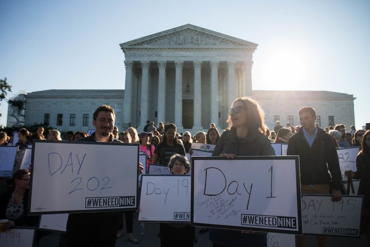 Demonstrators hold signs during a protest urging the U.S. Senate to hold a confirmation vote for Supreme Court nominee M