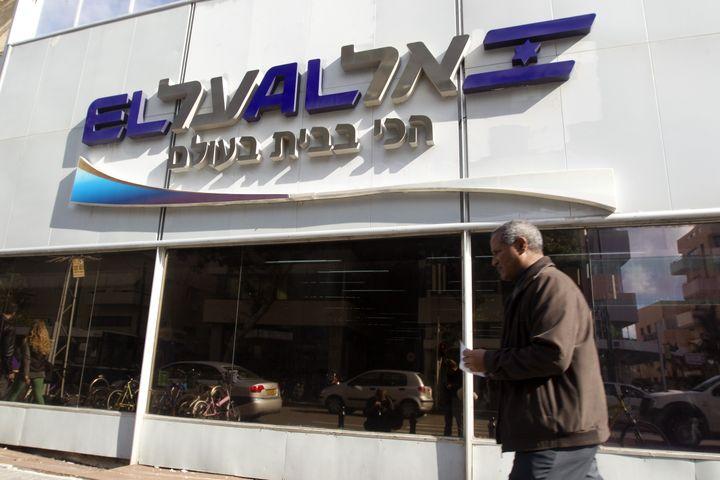 A man walks past an office of the Israeli airline El Al in Tel Aviv on Jan. 16, 2012.
