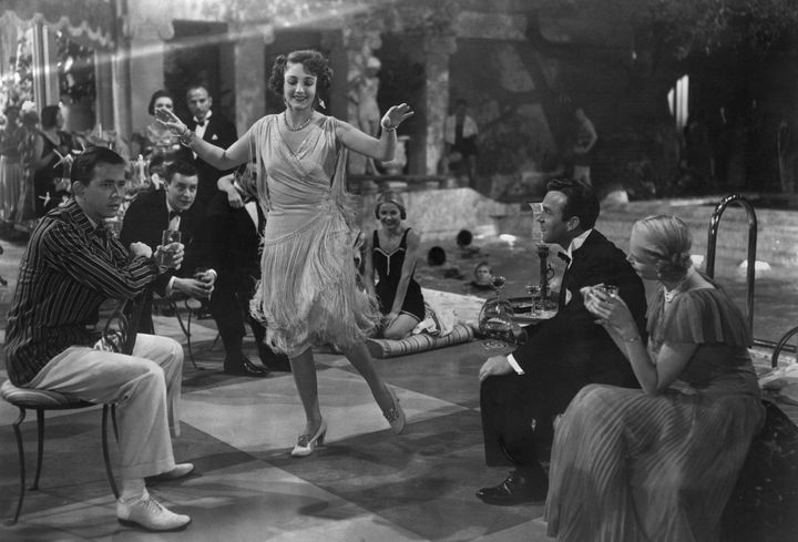 "Actress Betty Field dances the Charleston during a poolside party scene from the 1949 movie ""The Great Gatsby,"" based on the"