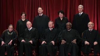 WASHINGTON, DC - JUNE 01:  Front row from left, U.S. Supreme Court Associate Justice Ruth Bader Ginsburg, Associate Justice Anthony M. Kennedy, Chief Justice John G. Roberts, Associate Justice Clarence Thomas, and Associate Justice Stephen Breyer, back row from left, Associate Justice Elena Kagan, Associate Justice Samuel Alito Jr., Associate Justice Sonia Sotomayor, and Associate Justice Neil Gorsuch pose for a group portrait in the East Conference Room of the Supreme Court June 1, 2017 in Washington, DC. The U.S. Supreme Court held a photo opportunity for photographers after Justice Gorsuch joined as the newest member. (Photo by Alex Wong/Getty Images)