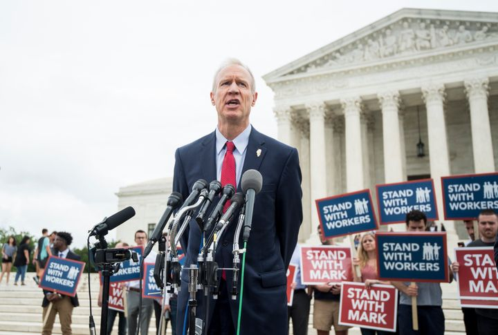 Illinois Gov. Bruce Rauner (R) speaks outside the U.S. Supreme Court after its decision on Wednesday.