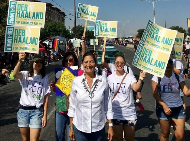 Deb Haaland walks with some supporters in Albuquerque.