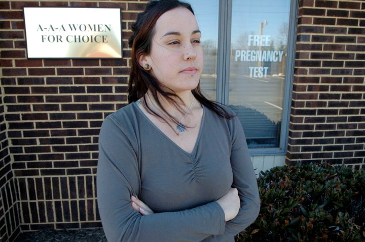 Allyson Kirk, 24, stands outside the A-A-A Women For Choice clinic, a crisis pregnancy center, March 2, 2007, in Manassas, Vi