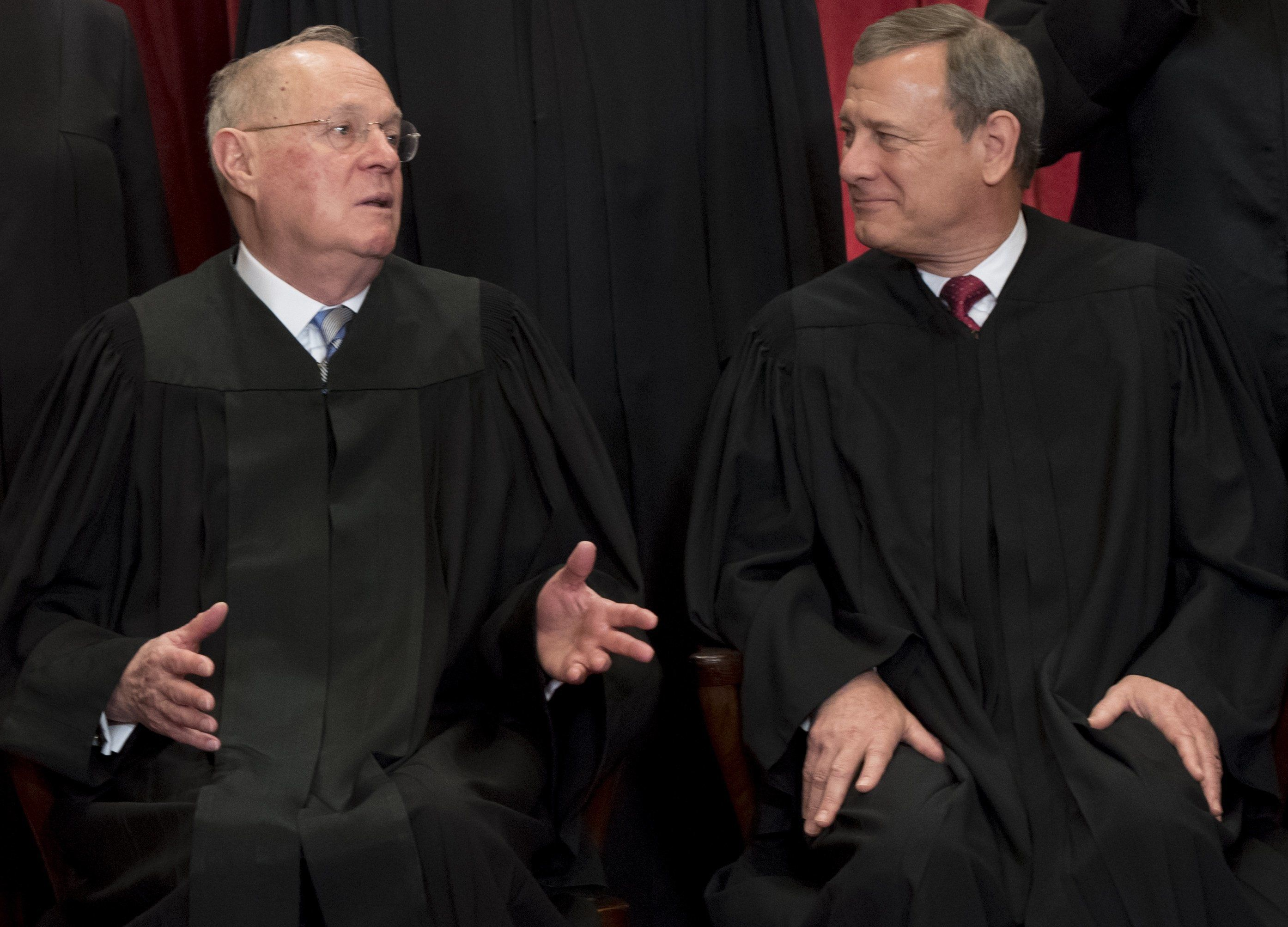 Chief Justice of the United States John G. Roberts (R) and US Supreme Court Associate Justice Anthony M. Kennedy (L) sit for an official photo with other members of the US Supreme Court in the Supreme Court in Washington, DC, June 1, 2017. / AFP PHOTO / SAUL LOEB        (Photo credit should read SAUL LOEB/AFP/Getty Images)