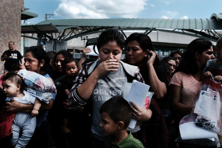 Dozens of women and children, many fleeing poverty and violence in Honduras, Guatemala and El Salvador, arrive at a bus stati