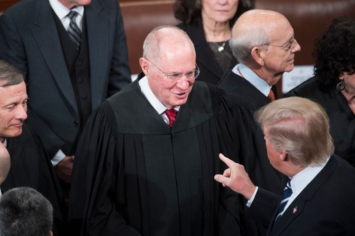 President Donald Trump greets Supreme Court Justice Anthony Kennedy after addressing a joint session of Congress in the Capit