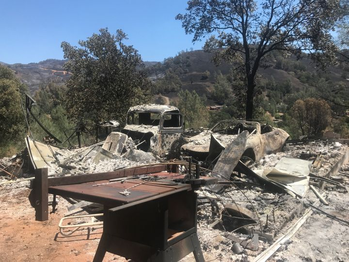 Two cars destroyed by wildfire at a home in Spring Valley, California. As of Wednesday, the Pawnee Firehad scorched mor